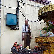 May 09, 2013 - Yangon, Myanmar: A devotee prays at Sule Pagoda in central Yangon. CREDIT: Paulo Nunes dos Santos
