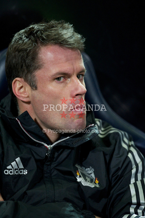 BOLTON, ENGLAND - Saturday, January 21, 2011: Liverpool's substitute Jamie Carragher sits on the bench before the Premiership match against Bolton Wanderers at the Reebok Stadium. (Pic by David Rawcliffe/Propaganda)