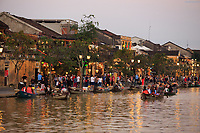 As twilight falls upon Bach Dang Street tourists take to boats on the Thu Bon river to enjoy the view.