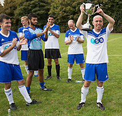 © Licensed to London News Pictures . 28/09/2014 . Birmingham , UK . Journalists celebrate their victory with captain Rob Merrick (who was injured during a tackle with Ed Balls in a match last week) holding their cup aloft . Conservative Party vs Journalists football match at a Birmingham University football pitch , at the start of the conference . The 2014 Conservative Party Conference in Birmingham . Photo credit : Joel Goodman/LNP