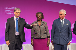 Bill Gates (left) holds a mini drone, watched by the Prince of Wales (right) and Rwanda's Minister of Foreign Affairs Louise Mushikiwabo at the Malaria Summit in 8 Northumberland Avenue, London, during the Commonwealth Heads of Government Meeting.