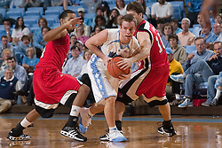 28 December 2006: North Carolina Tarheel guard (15) Dewey Burke guarded by Rutgers guard (10 Jon Mimmo during a 87-48 Rutgers Scarlet Knights loss to the North Carolina Tarheels, in the Dean Smith Center in Chapel Hill, NC.<br />