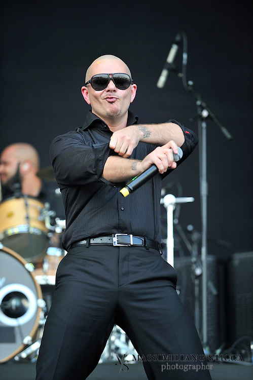 Heineken Jammin Festival 2012 <br /> Armando P&eacute;rez (born January 15, 1981), better known by his stage name Pitbull, is an American rapper, songwriter, and record producer. His first recorded performance was from the Lil Jon album Kings of Crunk in 2002. In 2004, he released his debut album titled M.I.A.M.I. (short for Money Is A Major Issue) under TVT Records. He released El Mariel in 2006 and The Boatlift in 2007.[3] In 2009, the album Rebelution spawned the hit single &quot;I Know You Want Me (Calle Ocho)&quot;. Pitbull's 2011 album, Planet Pit, featured the single &quot;Give Me Everything&quot; which was his first number-one single on the Billboard Hot 100. The song reached #1 worldwide and featured artists Ne-yo, Nayer, and Afrojack.