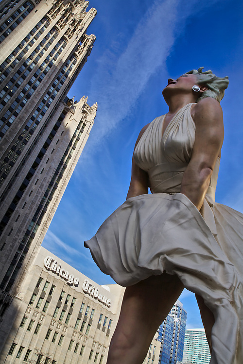 "At 26-feet, a towering sculpture of Marilyn Monroe's famous pose from the film ""The Seven Year Itch"" is revealed on Chicago's Magnificent Mile. ""Forever Marilyn"" by artist J. Seward Johnson."
