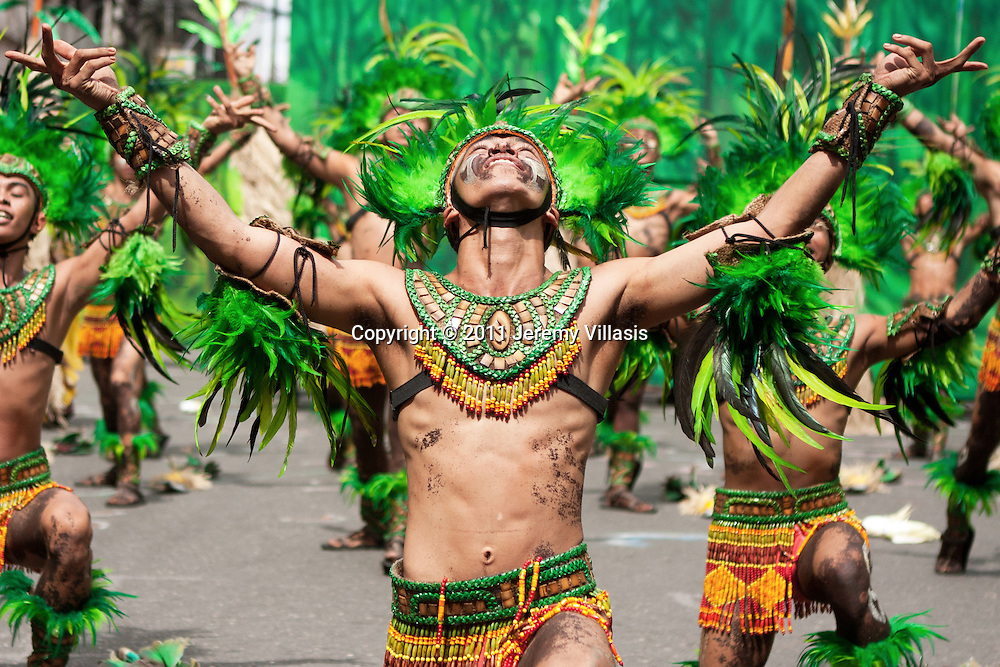 Tribu Paghidaet perform during the 2011 Dinagyang Ati-Ati competition in Iloilo City, the Philippines.<br />
