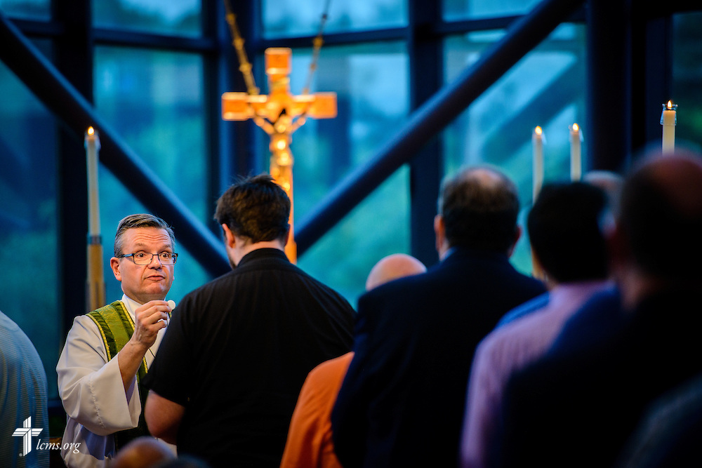The Rev. Kevin Robson, LCMS chief mission officer, distributes the sacrament at worship during floor-committee weekend at the International Center of The Lutheran Church–Missouri Synod on Saturday, May 28, 2016, in Kirkwood, Mo. LCMS Communications/Erik M. Lunsford
