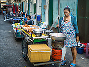 30 DECEMBER 2015 - BANGKOK, THAILAND:   Street vendors next to Bang Chak Market. The market is supposed to close permanently on Dec 31, 2015. The Bang Chak Market serves the community around Sois 91-97 on Sukhumvit Road in the Bangkok suburbs. About half of the market has been torn down. Bangkok city authorities put up notices in late November that the market would be closed by January 1, 2016 and redevelopment would start shortly after that. Market vendors said condominiums are being built on the land.           PHOTO BY JACK KURTZ