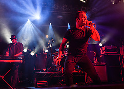 © Licensed to London News Pictures. 07/05/2014. London, UK.   Future Islands performing live at The Electric Ballroom.  In this picture - Samuel T Herring (centre), Gerrit Welmers (left).  Future Islands is a synthpop band based in Baltimore, Maryland, signed to 4AD. The band is composed of Gerrit Welmers (keyboards and programming), William Cashion (bass, acoustic and electric guitars), and Samuel T. Herring (lyrics and vocals).  Photo credit : Richard Isaac/LNP