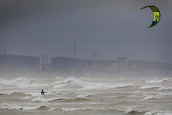 © Licensed to London News Pictures. 20/11/2016. Shoreham, UK. A kite surfer takes advantage of Storm Angus waves - in sight of Brighton seafront. The south east has experienced winds of up to 80 miles per hour as the first named storm of the season hits. Photo credit: Peter Macdiarmid/LNP