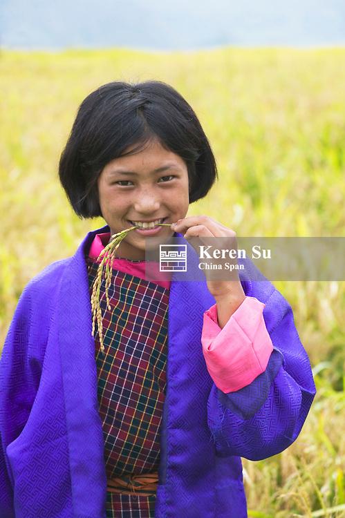 Portrait of a Bhutan girl in the rice paddy, Metshina village, Wangdi, Bhutan