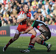 Twickenham, GREAT BRITAIN, Gloucester's James SIMPSON-DANIEL runs into Chris ROBSHAWS tackle, during the Guinness Premiership match, Harlequins vs Gloucester Rugby at the Twickenham Stoop.  Sat. 23rd Feb 01.03.2008.  [Mandatory Credit, Peter Spurrier/Intersport-images]
