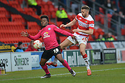 Shaquile Coulthirst (39) of Peterborough United and Aaron Taylor-Sinclair (20) of Doncaster Rovers   during the Sky Bet League 1 match between Doncaster Rovers and Peterborough United at the Keepmoat Stadium, Doncaster, England on 19 March 2016. Photo by Ian Lyall.