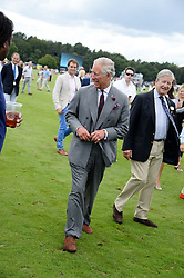 HRH The PRINCE OF WALES at the Audi International Polo at Guards Polo Windsor Great Park, Egham, Surrey on 28th July 2013.
