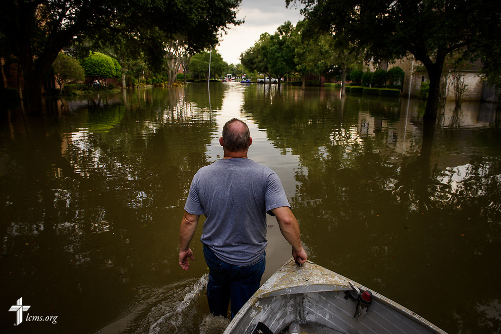 David Kunz of Memorial Lutheran Church, Houston, walks a boat through a flooded neighborhood on Monday, Sept. 4, 2017, in Houston. LCMS Communications/Erik M. Lunsford