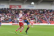 Doncaster Rovers forward Andy Williams (11) Scunthorpe United defender Murray Wallace (5)  during the EFL Sky Bet League 1 match between Doncaster Rovers and Scunthorpe United at the Keepmoat Stadium, Doncaster, England on 17 September 2017. Photo by Ian Lyall.