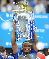 Chelsea's Didier Drogba lifts the trophy.  - Photo mandatory by-line: Alex James/JMP - Mobile: 07966 386802 - 24/05/2015 - SPORT - Football - London - Stamford Bridge - Chelsea v Sunderland - Barclays Premier League