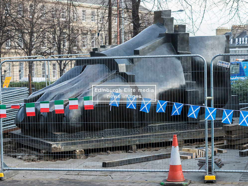 One of the three sculptures that make up The Manuscript of Monte Cassino by Eduardo Paolozzi has been removed from its site on Edinburgh's Picardy Place to allow works on the new St James quarter.<br /> <br /> Local residents have expressed concern that the sculpture won't return to the original site when the works have completed.<br /> <br /> The work was commissioned by entrepreneur, Sir Tom Farmer and remembers the bombing during WW2 of the Monte Cassino monastery - close to the artists family home.<br /> <br /> Pictured: The largest piece of the three sculptures is the Foot which will be moved on December 13