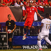 Chile Defender MAURICIO ISLA (4) dives for the ball as Panama Defender LUIS HENRIQUEZ (17) watches in the first half of a Copa America Centenario Group D match between the Chile and Panama Tuesday, June. 14, 2016 at Lincoln Financial Field in Philadelphia, PA.