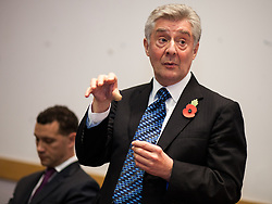 © Licensed to London News Pictures . 06/11/2012 . Manchester , UK . Labour candidate Tony Lloyd speaking as UKIP candidate Steven Woolfe listens . Manchester Police and Crime Commissioner debate this evening (6th November 2012) , at the Roscoe Building , the University of Manchester . Elections for 41 local Police and Crime Commissioners take place across the UK on 15th November 2012 . Photo credit : Joel Goodman/LNP