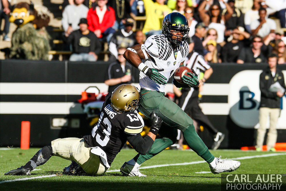 October 5th, 2013:  University of Oregon Ducks senior wide receiver Josh Huff (1) is pulled down by Colorado Buffaloes senior defensive back Parker Orms (13) in the first half of action in the NCAA football game between the University of Oregon Ducks and the Colorado Buffaloes at Folsom Field in Boulder, Colorado