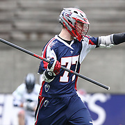 Kyle Sweeney #77 of the Boston Cannons directs his teammates during the game at Harvard Stadium on April 27, 2014 in Boston, Massachusetts. (Photo by Elan Kawesch)