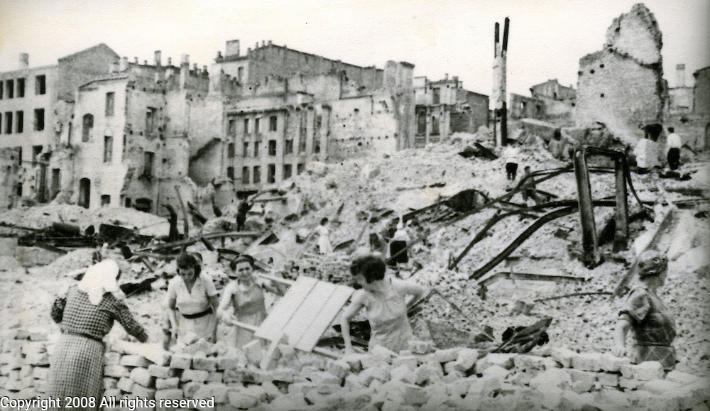 Soviet women dig through the rubble of destroyed Kiev, Ukraine during World War II. This image is from the archive of a photojournalist who photographed WWII for the Red Army.