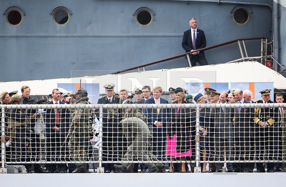 © Licensed to London News Pictures. 24/10/2018. London, UK. Dutch Marines walk a hostage past King Willem-Alexander,  Queen Maxima, Sophie of Wessex, Prince Edward and the Duke of Kent, on board HNLMS Zeeland during the exercise. British Royal Marines are joined by the The Royal Netherlands Marines in a military demonstration at HNLMS Zeeland, which is anchored next to anchored next to HMS Belfast on the River Thames in central London. Members of the British and Dutch Royal families watched the event as part of a state visit to the UK. Photo credit: Ben Cawthra/LNP