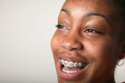 Portrait of a teenage girl laughing,