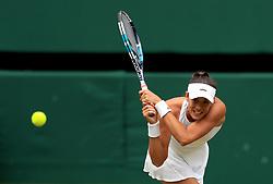 Garbine Muguruza in action against Magdalena Rybarikova on day ten of the Wimbledon Championships at The All England Lawn Tennis and Croquet Club, Wimbledon.