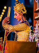 "03 NOVEMBER 2017 - BANGKOK, THAILAND: A traditional Thai dancer performs during Loi Krathong at Wat Prayurawongsawat on the Thonburi side of the Chao Phraya River. Loi Krathong is translated as ""to float (Loi) a basket (Krathong)"", and comes from the tradition of making krathong or buoyant, decorated baskets, which are then floated on a river to make merit. On the night of the full moon of the 12th lunar month (usually November), Thais launch their krathong on a river, canal or a pond, making a wish as they do so. Loi Krathong is also celebrated in other Theravada Buddhist countries like Myanmar, where it is called the Tazaungdaing Festival, and Cambodia, where it is called Bon Om Tuk.     PHOTO BY JACK KURTZ"
