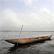 Beninese Pirogues at dawn on the lagoon of Ganvie in Cotonou, Benin on March 1, 2008.