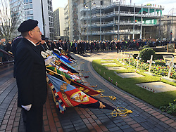 RETRANSMITTED CORRECTING CAPTION<br /> Veterans observe a two minute silence outside Birmingham's Hall of Memory on Armistice Day.