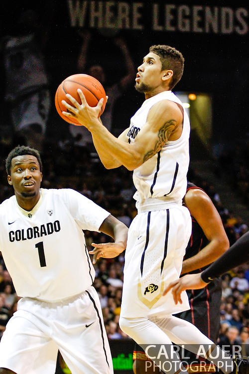 January 18th, 2014:  Colorado Buffaloes junior guard Askia Booker (0) glides to the basket in the second half of action in the NCAA Basketball game between the USC Trojans and the University of Colorado Buffaloes at the Coors Events Center in Boulder, Colorado