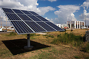 "Greensburg, Kansas, USA..Solar panel at The Greensburg Silo Home. (In the back the construction  site of the Kiowa County Commons.)..With precast concrete walls and a cylindrical form, this house will stand up to very strong winds. It also has a LEED rating of level 47. The Greensburg Silo Home is a part of The Chain of Eco-Homes--a series of twelve green houses that will serve as ""living laboratories"" featuring all types of building techniques, energy efficiency features, and green living products. Each will be available both as an informational center and as eco-lodging where people can experience green living first-hand...Greensburg GreenTown is a grassroots community-based organization which has worked side-by-side with city and county officials, business owners and local residents to incorporate sustainable principles into their rebuilding process. GreenTown serves as an educational resource for the community, a conduit through which donations can be distributed, and a representative to those outside the community who are interested in the Green Initiative...""Greensburg: Better, Stronger, Greener!"".On May 4, 2007, an EF5 tornado cut a 1.7-mile path of destruction through Greensburg, Kansas. Winds reaching speeds of 205 miles per hour uprooted trees, demolished homes and leveled the town. Eleven people died and 95% of the buildings were destroyed beyond repair. Residents have since worked furiously to rebuild it in a way that is both economically and environmentally sustainable and to meet the highest environmental standards. Greensburg, whose population has dropped from about 1400 to 800 following the storm and is now growing again, is currently the greenest town in America and the first in the United States to pass a resolution to certify that all city-owned buildings earn LEED Platinum accreditation, the highest level of the LEED rating system...Photo © Stefan Falke"