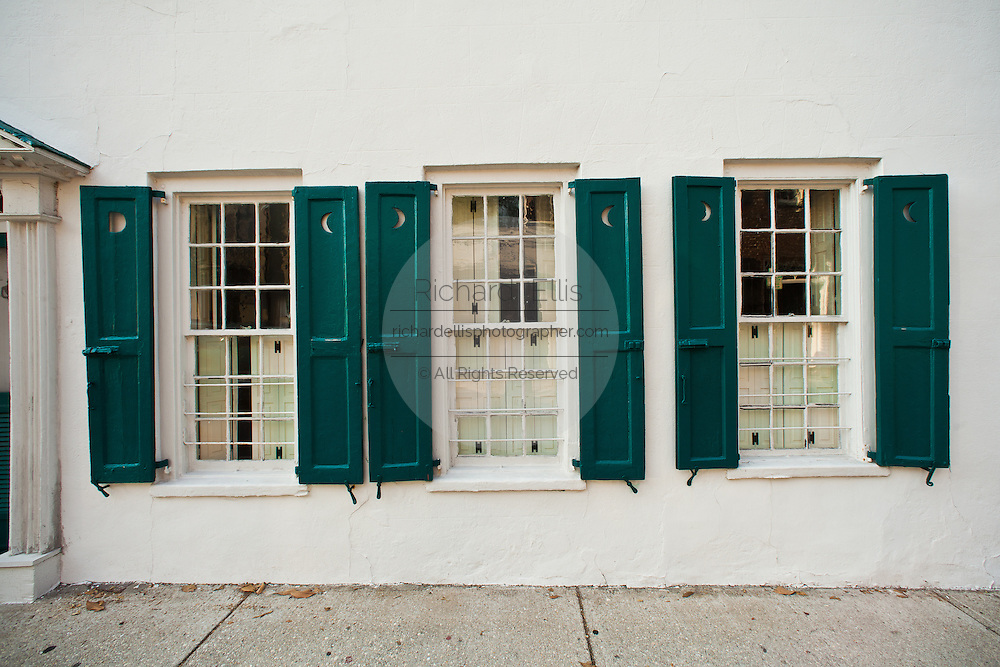 Antique windows and shutters with half-moon design Charleston, SC.