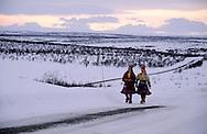 Samis (lap people), Young Samis near the Lavous, traditional tent (like an Indian Teepee)  Lapland  Norway        Les Samis (lapons); jeunes Samis près des lavous, la tente traditionnelle des lapons, qui ressemble à un tepee indien.   Laponie,   Norvege       L004791  /  R00330  /  P111353