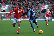 Bristol City defender Mark Little and Birmingham City midfielder Jacques Maghoma tussle for the ball during the Sky Bet Championship match between Bristol City and Birmingham City at Ashton Gate, Bristol, England on 30 January 2016. Photo by Alan Franklin.