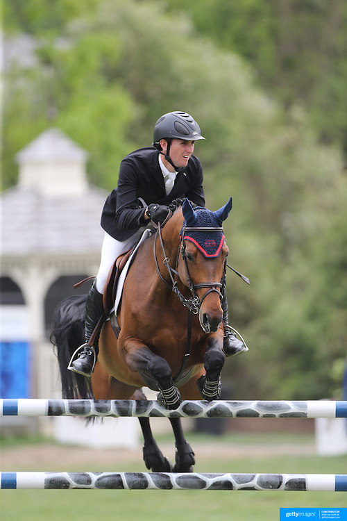 Michael Hughes riding Luxina in action during the $35,000 Grand Prix of North Salem presented by Karina Brez Jewelry during the Old Salem Farm Spring Horse Show, North Salem, New York, USA. 15th May 2015. Photo Tim Clayton