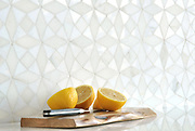 Esmeralda is a handmade mosaic shown in polished Calacatta Monet and honed Thassos, is part of The Studio Line of Ready to Ship mosaics.