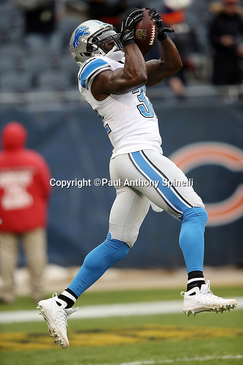 Detroit Lions strong safety James Ihedigbo (32) jumps and catches a pass while warming up before the NFL week 17 regular season football game against the Chicago Bears on Sunday, Jan. 3, 2016 in Chicago. The Lions won the game 24-20. (©Paul Anthony Spinelli)