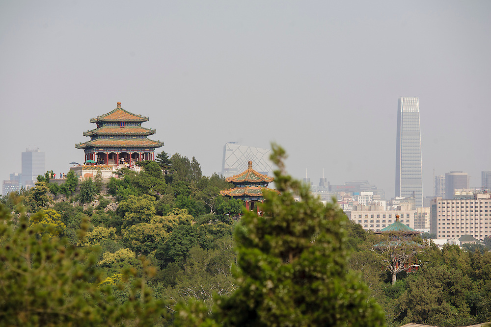 The Behai Park in Beijing with the city background.