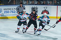 KELOWNA, CANADA - MARCH 14: Ryan Schoettler #16 of the Prince George Cougars is checked by Erik Gardiner #12 and Jack Cowell #8 of the Kelowna Rockets  on March 14, 2018 at Prospera Place in Kelowna, British Columbia, Canada.  (Photo by Marissa Baecker/Shoot the Breeze)  *** Local Caption ***