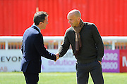 Exeter City manager Paul Tisdale greeting Plymouth officials before the Sky Bet League 2 match between Exeter City and Plymouth Argyle at St James' Park, Exeter, England on 2 April 2016. Photo by Graham Hunt.
