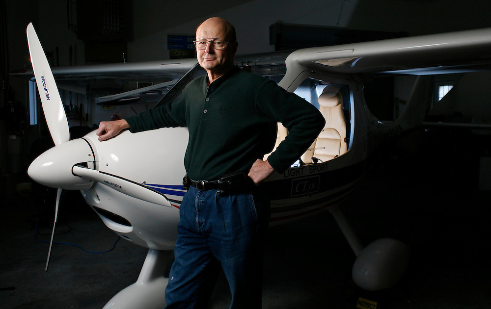 John Horn is photographed with his Flight Design CTsw light sport aircraft in the hanger of his home in the Independence Airpark on Friday, Dec. 10, 2009. Recent adjustments of the FAA compliance regulations could jeopardize residents of the airpark access to the Independence State Airport.