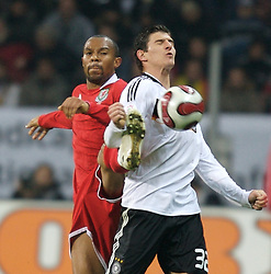 FRANKFURT, GERMANY - Wednesday, November 21, 2007: Wales' Daniel Gabbidon and Germany's Mario Go?mez during the final UEFA Euro 2008 Qualifying Group D match at the Commerzbank Arena. (Pic by David Rawcliffe/Propaganda)