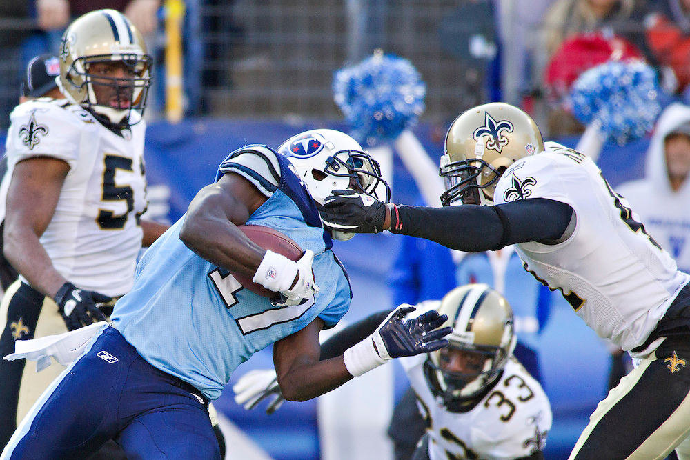 NASHVILLE, TN - DECEMBER 11:   Damian Williams #17 of the Tennessee Titans is tackled by the face mask by Roman Harper #41 of the New Orleans Saints at LP Field on December 11, 2011 in Nashville, Tennessee.  The Saints defeated the Titans 22-17.  (Photo by Wesley Hitt/Getty Images) *** Local Caption *** Damian Williams; Roman Harper