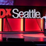 Tall Order TEDx Seattle 2018. Judy Twedt (scientist/artist) with accompanist Kristina Lee. Photo by Alabastro Photography.