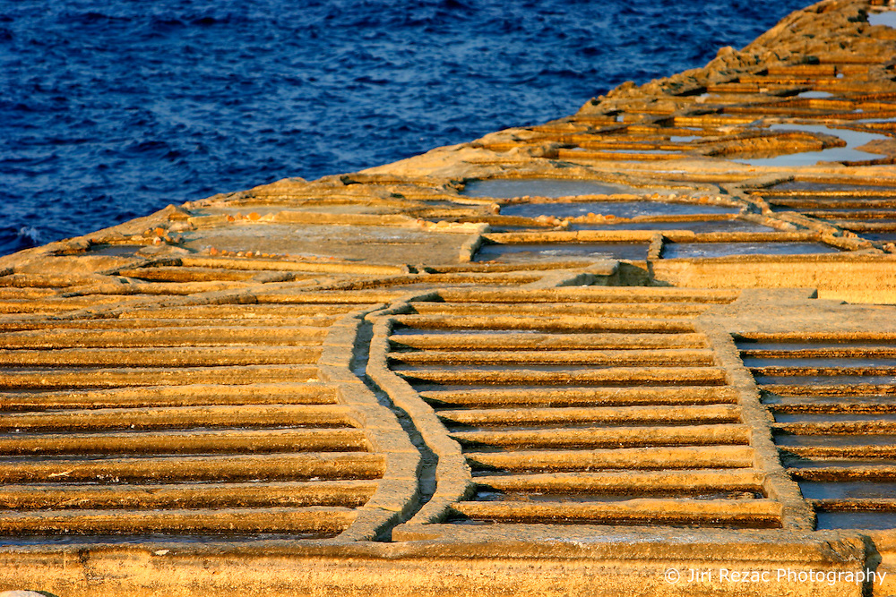 MALTA GOZO XWEJNI 20JUL06 - The Xwejni saltpans near Marsalforn, Gozo form a 50-metre wide stretch of about 2 Km of coastline. The slight depressions in the limestone form little basins in which seawater evaporates during the summer months leaving behind a crust of salt crystals...jre/Photo by Jiri Rezac..© Jiri Rezac 2006..Contact: +44 (0) 7050 110 417.Mobile: +44 (0) 7801 337 683.Office: +44 (0) 20 8968 9635..Email: jiri@jirirezac.com.Web: www.jirirezac.com
