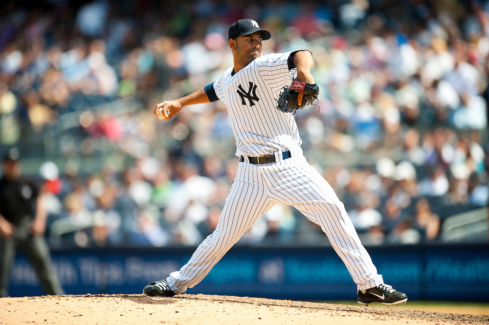 NEW YORK - JULY 27: Hector Noesi #64 of the New York Yankees pitches during the game against the Seattle Mariners at Yankee Stadium on July 27, 2011 in the Bronx borough of Manhattan. (Photo by Rob Tringali) *** Local Caption *** Hector Noesi