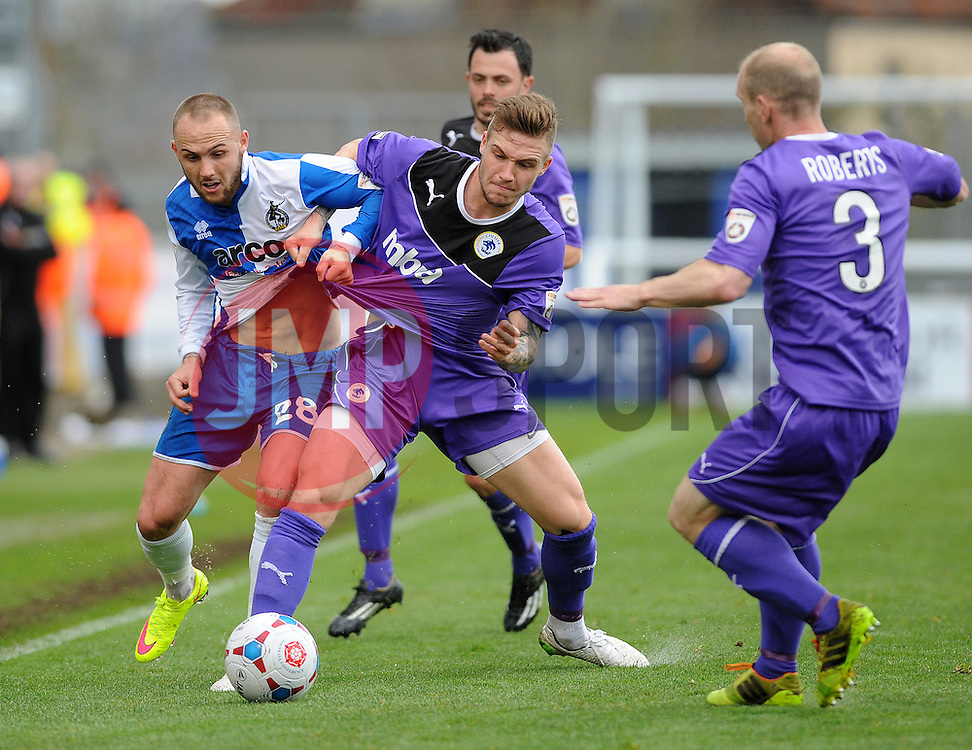 Bristol Rovers' Adam Dawson challenges Chester's Brad Abbott  - Photo mandatory by-line: Neil Brookman/JMP - Mobile: 07966 386802 - 03/04/2015 - SPORT - Football - Bristol - Memorial Stadium - Bristol Rovers v Chester - Vanarama Football Conference